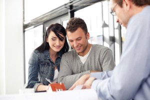Couple signing fha loan